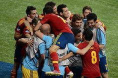 Spain's national football team celebrate after scoring their third goal during the Euro 2012 football championships final match Spain vs Italy on July 1, 2012 at the Olympic Stadium in Kiev.