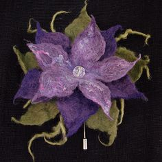 Yum!  Hand made by Diva Designs, fabulous! http://www.divadesignstudio.co.uk/shop/amethyst-felted-corsage/