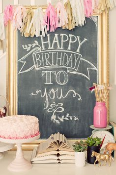 Pink birthday party table display with pink ombr cake. All the details and more pictures on the blog! Maggie Holmes