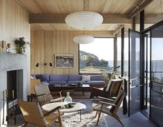 Beach House on Shelter Island with Hans Wegner armchairs, and Japanese Akari lanters from the Noguchi Museum.