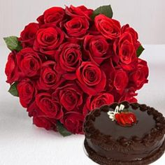 Vivid Red  (LOVERS PARADISE )  Nothing goes together like these roses and cake, This ultimate expression of love and romance is sure to captivate your loved one.( 20 Red roses Bunch with half kg.chocolate truffle cake)