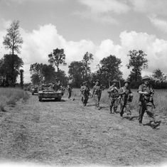 Universal carriers and infantry of (Scottish) Division move forward during Operation 'Bluecoat', the offensive south-east of Caumont, 30 July Division, Normandy Invasion, British Army Uniform, D Day Landings, Ww2 Tanks, Blue Coats, Armored Vehicles, Military History, World War Two
