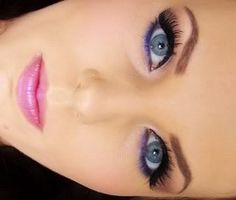 Hint of purple- Never thought of purple for my blue eyes but that looks good on this chick