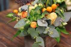 Privet, cumquats, roses, anemones and eucalyptus in our this arrangement from a Farmgirl Flowers student.