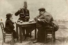 A French postcard with the tallest, shortest, and fattest men of Europe playing a game of cards, circa 1913.