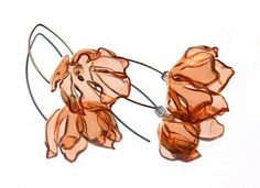 orange poppy on an oversizes solid silver hook. poppy is made from recycled pet bottles.