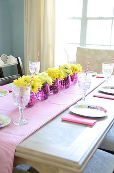 simple flower arrangement down your dining table with pinwheels in a few of them