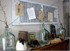 Would use the shutter plain I think or add a small twiggy wreath to it and I LOVE the glass bottles with twigs.
