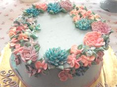 Cake made by Fancy Cakes by Leslie - beautiful buttercream flowers