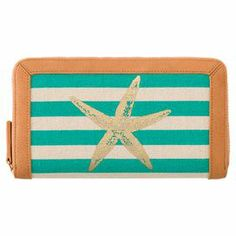 """Keep credit cards and cash organized in style with this zippered canvas wallet, showcasing a starfish motif and aqua stripe accent.  Product: WalletConstruction Material: Cotton canvas and bicast leatherColor: AquaFeatures:  Zippered closureTwo credit card wallsTwo bill slots One ID window One coin pouch Gold hardwareStarfish motif  Dimensions: 4.5"""" H x 7.75"""" W x 1"""" D"""