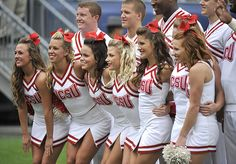 9/8/2012 Mike Orazzi   Staff  North Carolina State University cheerleaders during a 10-7 NC State win at Rentschler Field in East Hartford on Saturday.      Video slideshow with more photos here: youtu.be/iPVPPadYn60