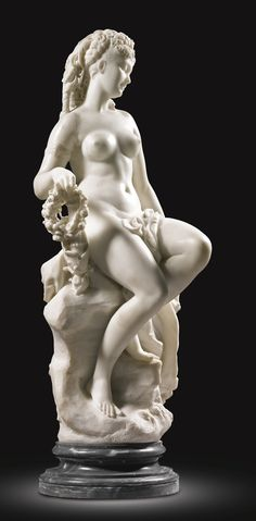 Jean-Baptiste-Gustave Deloye FRENCH 1838 - 1899. JEUNE FEMME NUE (NUDE YOUNG WOMAN) signed: GUSTAVE / DÉLOYE and dated: 70 -  white marble on a circular veined grey marble socle  83cm.