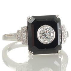 An 18ct white gold ring featuring a 0.30ct brilliant cut diamond set in an onyx panel. www.rutherford.com.au