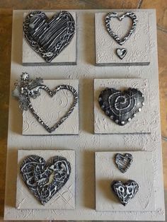 Glue gun used on wooden hearts, painted with black acrylics