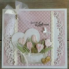Handmade card by DT member Astrid with Creatables Tiny's Tulip (LR0401), Tiny's Crocus (LR0400), Tiny's Basket (LR0404), Curved Border (LR0396, Craftables Heart - Basic Shape (CR1351) and Punch-die Butterflies (CR1354) from Marianne Design