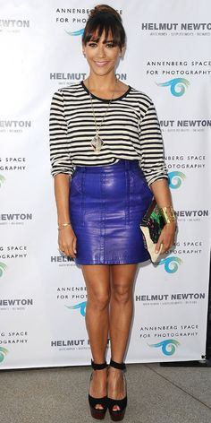 At the Helmut Newton event, Rashida Jones tagged her cobalt blue leather mini with some skinny black-and-white stripes. She paired her look with a statement pendant, gold cuff, floral clutch and chunky ankle-strap peep-toes.