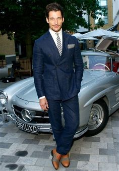 In a Club Monaco suit with Mercedes 300sl Gullwing (Rex Features)