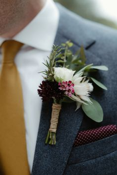Buttonhole   Catherine Deane Omelia Gown   Yurt Reception   Cad and The Dandy Suit   Wild Purple Flowers   Green Foliage   Copper Accents   DIY   Cinzia Bruschini   http://www.rockmywedding.co.uk/kate-steve