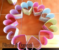 DIY heart wreath .... Wonder if I can do anything school related with this..??  It would be great if our story that week was on sequencing so we could write the events on the strips!
