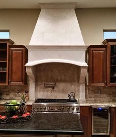 Absolutely stunning custom range hood produced in our factories and installed by the team at Kitchen AZ Cabinets & More.