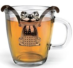 TEA INFUSER - FROG - While a frog hopping on a teacup is normally cause for a good amount of shrieking and screaming, that isn't the case at all with this adorable tea infuser that, true to its amphibian nature, is equally at home on land (your kitchen counter) and in water (hot or boiling, preferably). Made from...