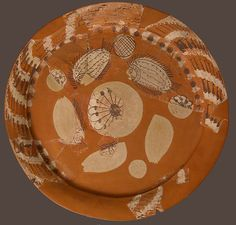 Fragmentary Platter with Fish and Rosettes Date: 500–700, modern restoration Geography: Made in Thebes, Byzantine Egypt Culture: Coptic Medium: Terracotta decorated with red, white and dark brown slip Dimensions: Overall: 20 3/8 x 1 7/8 in. (51.8 x 4.8 cm)