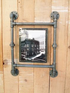 Pipe picture frame with a black and white photo of a Detroit building