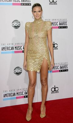 Heidi Klum wearing a high-necked, cap-sleeved gold embroidered mini from Alexandre Vauthier's Fall 2012 couture collection Victoria Models, Catwalk Models, See Through Dress, Shorts With Tights, Celebrity Look, Heidi Klum, Beautiful Legs, Female Models, Top Models