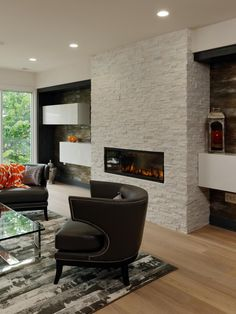 Floating shelves on either side of this white stone fireplace enhance this living room's contemporary look. Dark contrasting panels in the inset walls make the white shelves pop.