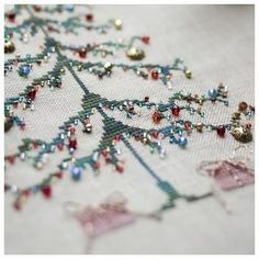"Love this idea of simple cross stitch tree ""decorated"" with ""ornaments"" = bead & charms treasures from your stash. Pattern is in the book ""Stitch"" by Penny Black Ribbon Embroidery, Cross Stitch Embroidery, Embroidery Patterns, Cross Stitch Patterns, Beaded Cross Stitch, Cross Stitch Tree, Simple Cross Stitch, Counted Cross Stitch Kits, Christmas Embroidery"