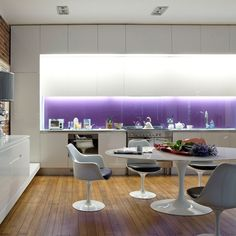 Purple glass led lit backsplash with white modern kitchen modern table and chairs and wooden floor want this look for my new home Purple Kitchen, New Kitchen, Kitchen Unit, Kitchen Ideas, Home Design, Modern Interior, Interior Design, Kitchen Interior, Interior Styling