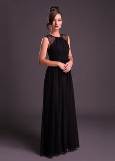 Elegant and #chic, this #black floor-length #dress from Bride&co #SouthAfrica with #sheer shoulder detail is perfect for an #engagement party. Click to view more or book a fitting with a #brideandco personal #style consultant. (Style VCWBM0247).
