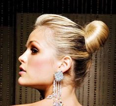 Blonde updo with shoulder dusters.