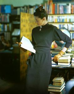 books0977:  Model reading a library book (c.1945). Photograph byConstantin Joffé.Image by © Condé Nast Archive/CORBIS.The model is wearing a dark brown dress by Henry Rosenthal, in cashmere-type wool jersey, by Potter, cork color Boxlav gloves, and jewelry by Karu.
