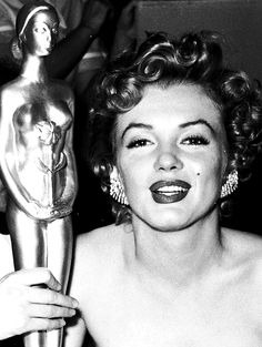 Marilyn at the Henrietta Awards with her award for Best Young Box Office Personality, February 1952.
