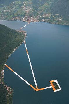 The Floating Piers - ITALY - SULZANO, MONTISOLA, ISOLA DI SAN PAOLO by CHRISTO AND JEANNE-CLAUDE - PHOTOS BY WOLFGANG VOLZ For 16 days Italy's Lake Iseo will be reimagined. 100,000 square meters of shimmering yellow fabric, carried by a modular floating dock system of 220,000 high-density poly-ethylene cubes, will undulate with the movement of the waves.