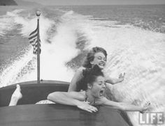Betty Brooks and Patti McCarty motor boating at Catalina Island, CA 1941 by Peter Stackpole
