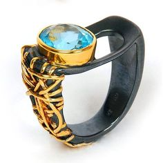 Beautiful ring by G. Kabirski. (Original source unvailable. Link goes to the official G. Kabirski website.)