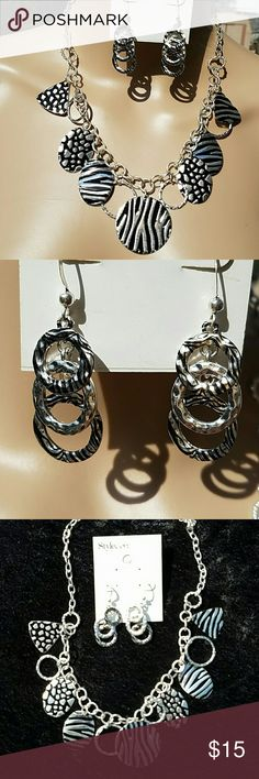 "Silver Necklace and Earrings Pretty 18"" silver chain with zebra-like stripes and spots on hanging discs  (that are each 1""-1 1/2"" long) . Excellent condition - necklace and earrings  never worn. Comes from smoke-free home. Jewelry Necklaces"