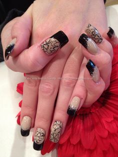 Nude and black polish with black flower freehand nail art