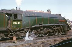 """LNER Class A4 Pacific 60034 """"Lord Faringdon"""" at Perth on the 08.25 Glasgow to Aberdeen express, 19th July 1966. (Bill Wright)"""