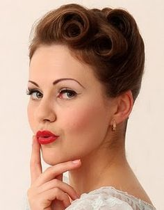 updo pin curl/victory roll combo