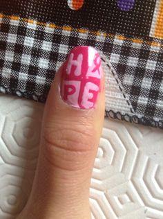 Breast cancer awareness nail art.