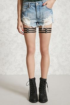 A multi-layered faux leather thigh garter featuring elasticized bands and snap-button closures.