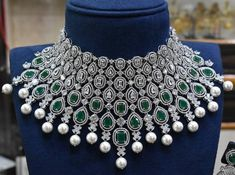 Stunning grand look choker studed with emeralds and American diamonds.it is plated with 24 ct gold polish. Bridal Necklace Set, Diamond Necklace Set, Wedding Jewelry, Diamond Jewelry, Gold Necklace, Wedding Rings, Indian Jewelry Earrings, Jewellery Box, Designer Jewellery