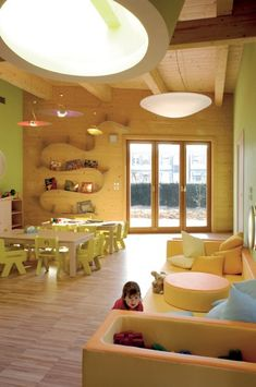 """Love the combination of the natural wood with the soft pastels.  Shelf adds visual interest, soft areas for children to """"land"""""""