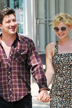 REAL: Marcus Mumford And Carey Mulligan  Because they were childhood pen pals. Because they shun the whole red-carpet-celebrity-couple thing. Because she wore Wellies on their wedding day.
