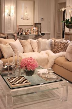 Pretty coffee table, fur blanket, cream and pink living room