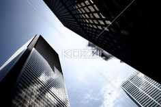 This is a extreme low angle shot of shadows on tall commercial buildings against sky. The blue of the sky contrast with the dull colours of the buildings. Low Angle Shot, Building Photography, Rule Of Thirds, Office Buildings, 1st Year, Light Project, Ant, Free Stock Photos, Research