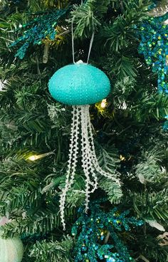 Christmas Ornaments, Christmas Decor, Christmas Tree Ornaments, Beach Ornaments, Unique Christmas Ornaments, Shell Ornaments, Jellyfish by Ancientvibrationshop on Etsy Beach Christmas Ornaments, Christmas Home, Christmas Decorations, Sea Urchin Shell, Shell Ornaments, Reusable Bags, Jellyfish, Handmade Shop, Delicate